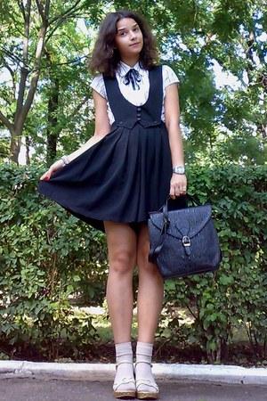 black satchel thrifted purse - black Zero shirt - neutral socks
