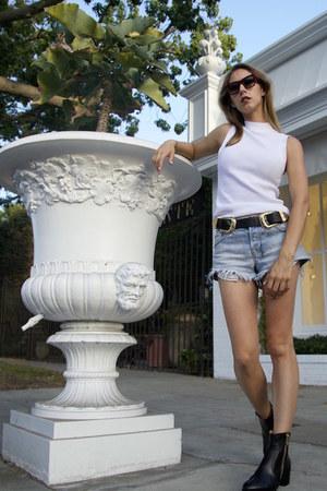 short Chanel boots - hayday Ksubi shorts - Celine sunglasses
