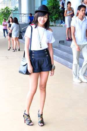 black shoes - black hat - white shirt - blue Pink Manila shorts