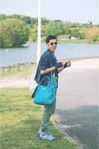 teal Prada bag