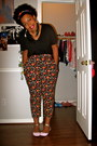 Black-vneck-shirt-head-scarf-crazy-print-pants-feather-earrings-pink-and