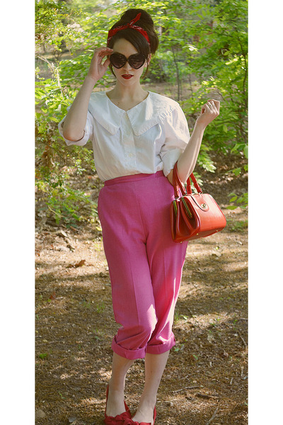 bubble gum thrifted pants - red inherited purse - black heart-shaped sunglasses