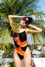 Orange-giant-vintage-sunglasses-black-swimwear-vintage-swimwear