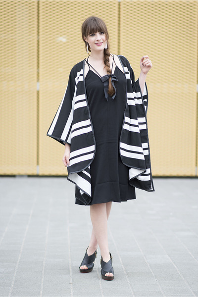 black H&M cape - black Clarks heels