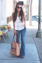 navy flare jeans - tan thesak bag - eggshell top