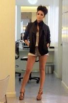 black edgy black jacket - cream laid back romper - brown sandals