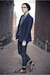 Black-boots-black-blazer-silver-shirt-periwinkle-tie-black-pants