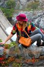 red vintage hat - red plaid shirt - orange leather purse - gray skinny pants
