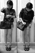 black patent Gibi heels - black leather Prada bag - navy cotton on shorts