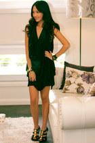 black asymmetrical Tempt dress - black Chanel bag - black enamel Hermes bracelet