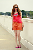 statement necklace - orange shorts - red top