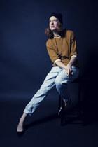 mustard perforated vintage sweater - light blue baggy vintage jeans - black hat