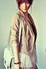 Light-brown-blazer-black-shirt-off-white-bag-beige-skirt