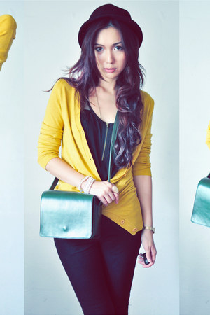 black shirt - dark green bag - mustard cardigan
