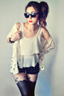 Beige-shirt-black-shorts-red-accessories