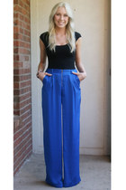 blue silk BCBG pants - black BCBG t-shirt - carrot orange Lily&Laura bracelet