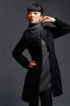 black rip studio coat