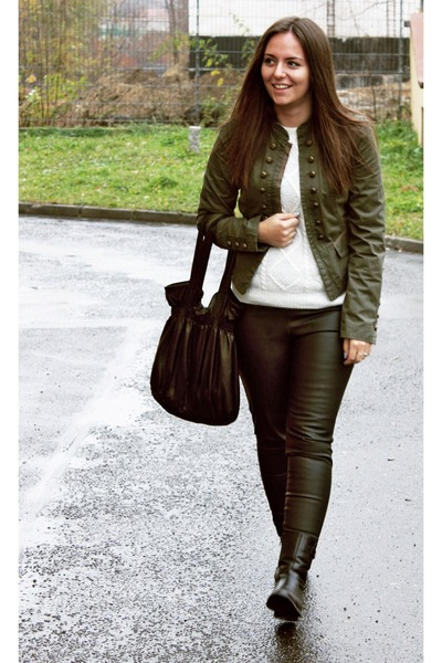 Olive Green Jackets, Black Bags, Black Pants, White Jumpers ...