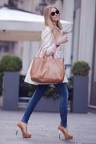 white coat - navy jeans - camel bag