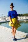 Blue-shoes-yellow-bag-white-sunglasses-yellow-skirt-blue-top