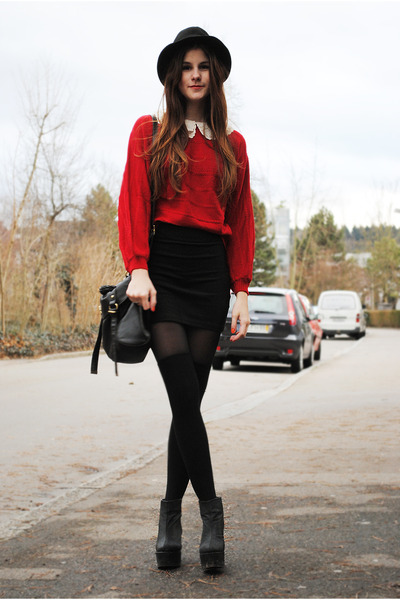 red sweater - black bag