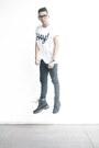 Black-high-cut-human-boots-white-printed-artwork-t-shirt