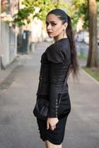 black leather maestro purse