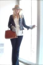 navy dark flare JBrand jeans - camel floppy hat Urban Outfitters hat - black bik