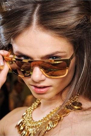 gold gold Chanel bracelet - navy denim Levis shorts - gold big YSL sunglasses
