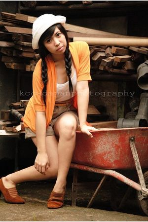 orange blazer - white top - brown shorts - gold belt - brown shoes - white hat
