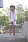 Black-hat-white-gaudi-shirt-black-sling-bag-aldo-bag-white-gaudi-shorts