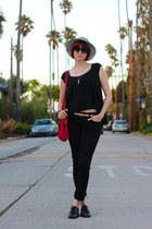 white thrifted vintage hat - black Levis jeans - red thrifted vintage bag