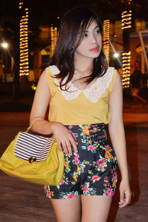 yellow bag - black floral print shorts - yellow top