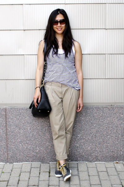 black coach bag - black Keds sneakers - tan pleated Cartonnier pants - navy stri