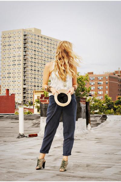 tan hat - dark khaki heels - white top - navy Urban Outfitters pants
