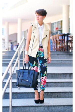 black mini luggage Celine bag - black floral pants - cream faux leather vest