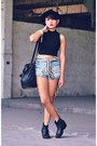 Black-harness-boots-black-studded-bucket-bag-blue-shorts-black-top