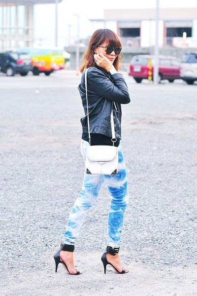 black faux leather jacket - blue tie-dyed jeans