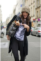 black bag - furry coat - cozy hat - black leggings - printed t-shirt