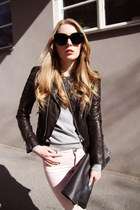 brown leather jacket - big clutch bag - black sunglasses