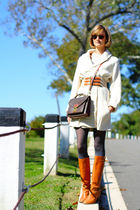 brown structured Louis Vuitton bag - orange knee-high KORS boots