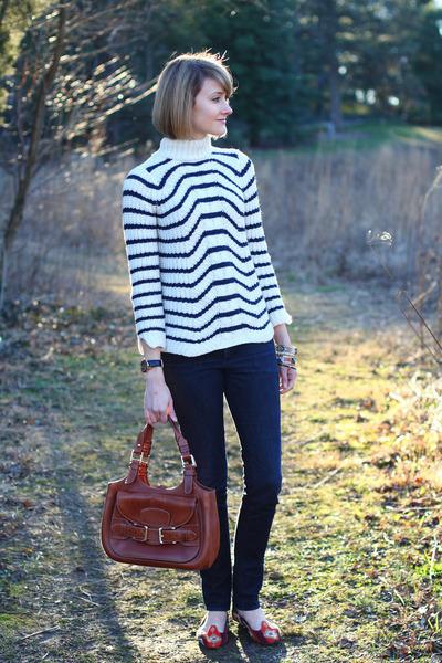 burnt orange saddle bag Bally bag - navy skinny H&M jeans