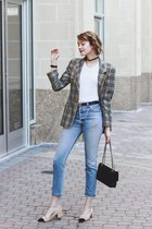 black quilted Chanel bag - sky blue mom jeans Re Dones jeans