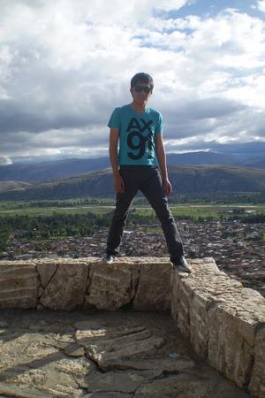 blue Armani Exchange t-shirt - gray Ripcurl sunglasses - black ferreti shoes - b