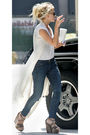 White-vest-blue-jeans-gold-shoes-black-purse-black-sunglasses-white-t-