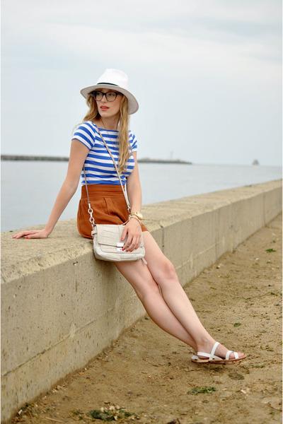 blue Zara shirt - white Target hat - cream coach bag
