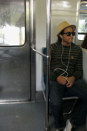 black jeans - green Element sweater - Element hat - black sunglasses - white Van