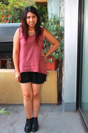 black boots - black shorts - pink top