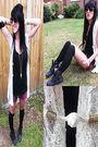 White-constructivepanic-shirt-black-boots-purple-constructivepanic-shorts