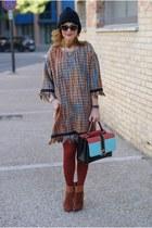 burnt orange Vogos dress - black COS hat - aquamarine Paula Cademartori bag